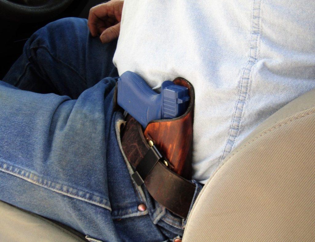 Tipo de porte de arma cruzado para conductores